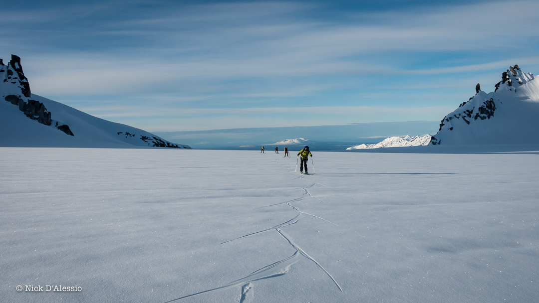 Skate skiing on the frozen glacier to our next objective while guiding in Alaska.