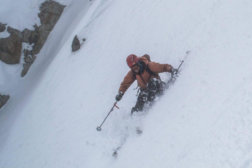 Telemark Ski Mountaineer alpine turn, SW couloir south