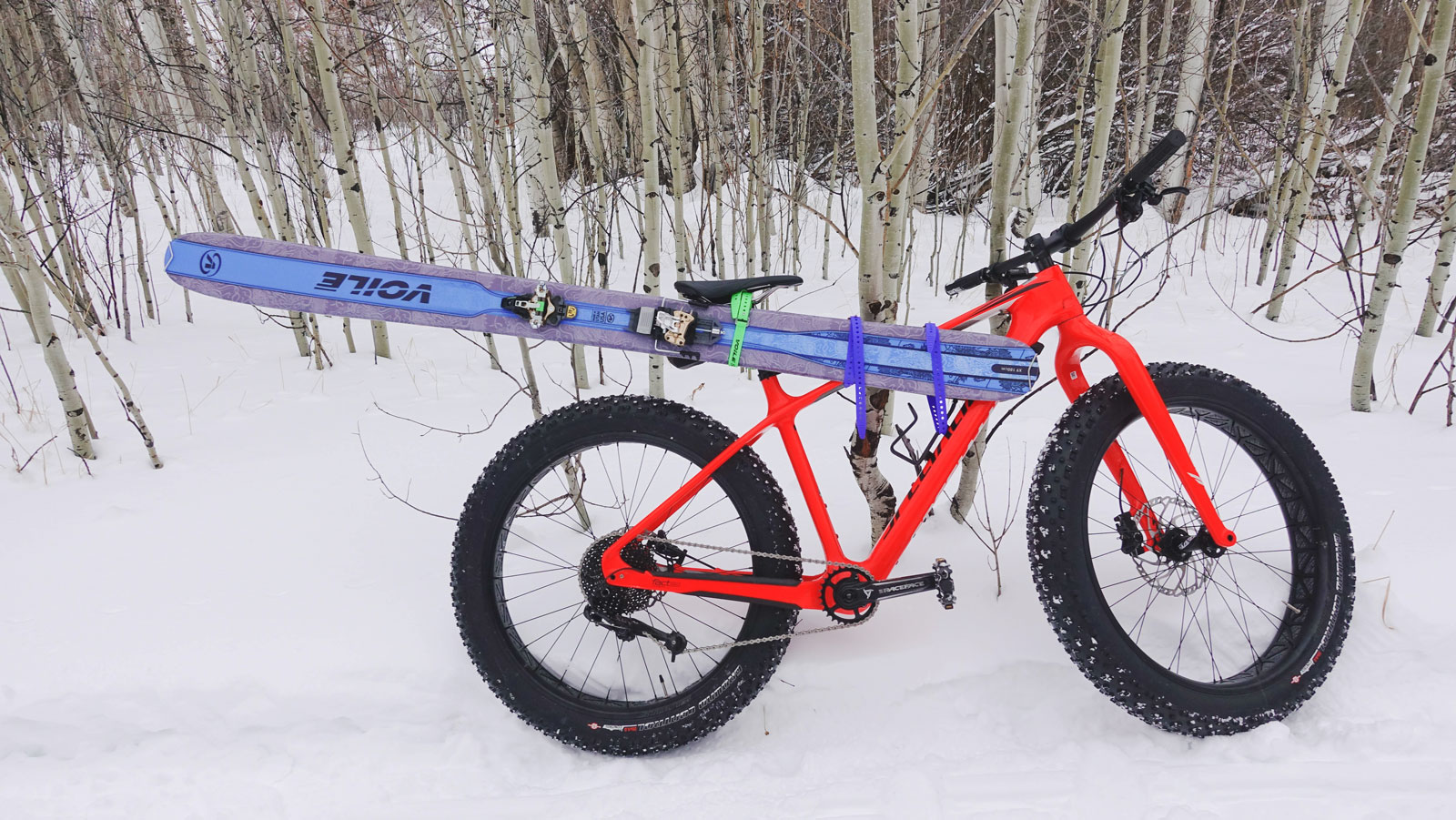 Snow bike with skis mounted to the frame.